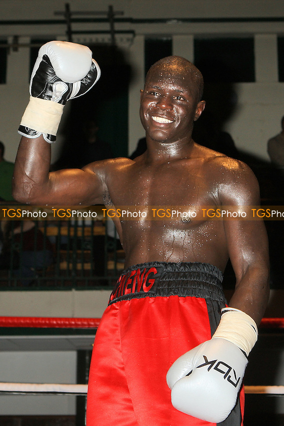 Erick Ochieng (red shorts) defeats Alex Spitko in a Middleweight boxing contest at York Hall, Bethnal Green, promoted by Steve Goodwin - 11/09/10 - MANDATORY CREDIT: Gavin Ellis/TGSPHOTO - SELF-BILLING APPLIES WHERE APPROPRIATE. NO UNPAID USE. TEL: 0845 094 6026