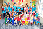 Staff Elaine Galvin, Aileen Gibbons, Laura Healy, Jackie McSweeney, Mary O'Keeffe, Aileen Kelliher, Karina Griffin and Kathleen Hussey with the children from Bud's Childcare Ballyduff.