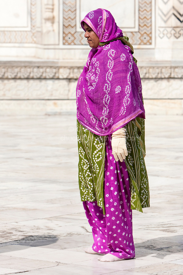 Agra, India.  Taj Mahal.  Indian Woman Wearing a Shalwar Kameez (Loose trousers topped by a long loose shirt) and Dupatta (scarf-like garment covering head and shoulders).