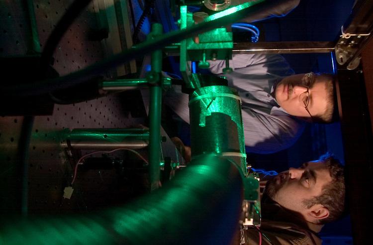 Green Laser Lab in Russ College:  Bradley Smith(gray Feece), Daniel Schaaff(brown shirt), Dr. Wojciech Jadwisienczak