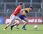 Ryan Burns of Louth  in action against Sean Collins of Clare during their national League game in Cusack Park. Photograph by John Kelly.