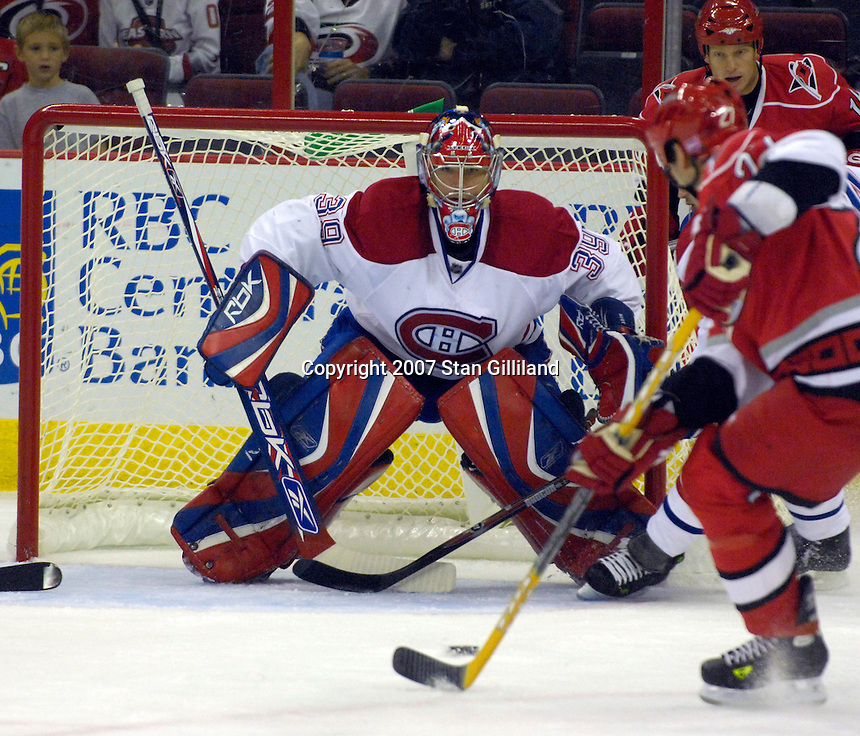 Montreal Canadiens goalie Cristobal Huet keeps an eye on the Carolina Hurricanes during their game Friday, Oct. 26, 2007 in Raleigh, NC. The Canadiens won 7-4.
