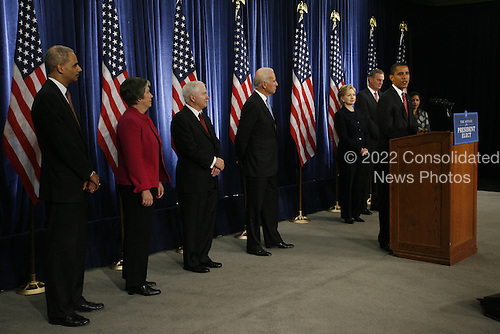 Chicago, IL - December 1, 2008 -- United States President-Elect Barack Obama gives a press conference with, left to right, Eric Holder nominated for Attorney General, Arizona Governor Janet Napolitano, picked for homeland security secretary, defense secretary Robert Gates, who will keep his current post, Vice President-elect Joe Biden, United States Senator Hillary Rodham Clinton (Democrat of New York), nominated for Secretary of State,  James L Jones, nominated as national security adviser and Susan Rice, picked for United Nations ambassador, Monday morning, December 1, 2008 at the Chicago Hilton & Towers in Chicago, Illinois.  .Credit: Anne Ryan - Pool via CNP