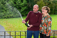Pictured: David and Lynne Price with celebrate with champagne after they won one million pounds at Bedwellty House,Tredegar, Blaenau Gwent, Wales, UK. Tuesday 12 November 2019<br /> Re: David Price from New Tredegar is the latest winner from Wales to join the Millionaire club just a week before The National Lottery marks 25 years since its first draw. David, 53, who loves the great outdoors, will use part of his windfall to put towards a dream trip to Mount Everest Base Camp next year.
