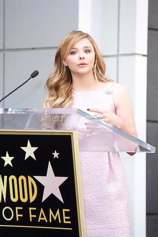 HOLLYWOOD, CA - OCTOBER 03: Actress Chloe Grace Moretz poses as Julianne Moore is honored with a star on the Hollywood Walk of Fame on October 3, 2013 in Hollywood, California. Credit: Sonboleh/RTN/MediaPunch Inc.