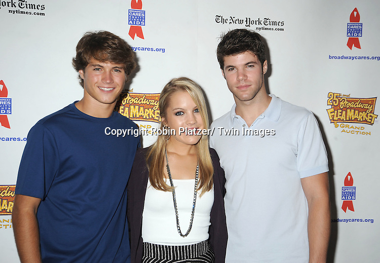 Andrew Trischitta, Kristen Alderson and Nik Robuck attends the 25th Annual Broadway Flea Market and Grand Auction benefiting Broadway Cares/ Equity Fights Aids on September 25, 2011 at Shubert Alley.