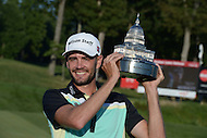 Gainesville, VA - August 2, 2015: Troy Merritt holds the Quicken Loans National trophy after winning the tournament at the Robert Trent Jones Golf Club in Gainesville, VA, August 2, 2015. Merritt won the tournament at -18. This was Merritt's first major PGA Tour win.  (Photo by Don Baxter/Media Images International)