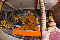 A Buddhist monk offering blessings, Phra Yai Temple, Koh Samui (island), Gulf of Thailand, Thailand
