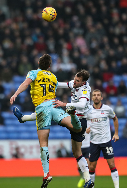 Bolton Wanderers' Christian Doidge competing with Rotherham United's Clark Robertson<br /> <br /> Photographer Andrew Kearns/CameraSport<br /> <br /> The EFL Sky Bet Championship - Bolton Wanderers v Rotherham United - Wednesday 26th December 2018 - University of Bolton Stadium - Bolton<br /> <br /> World Copyright © 2018 CameraSport. All rights reserved. 43 Linden Ave. Countesthorpe. Leicester. England. LE8 5PG - Tel: +44 (0) 116 277 4147 - admin@camerasport.com - www.camerasport.com