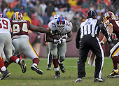 Landover, MD - November 30, 2008 -- New York Giants running back Brandon Jacobs (27) carries the ball in fourth quarter action against the Washington Redskins at FedEx Field in Landover, Maryland on Sunday, November 30, 2008.  The Giants won the game 23 - 7..Credit: Ron Sachs / CNP.(RESTRICTION: No New York Metro or other Newspapers within a 75 mile radius of New York City)