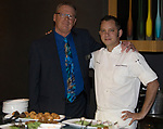 Charlie Palmer Restaurant Manger Les Arlin, left, with Chef Michael Mahoney during a cooking demonstration inside Charlie Palmer Lounge in the Grand Sierra Resort on Thursday night, October 12, 2017.