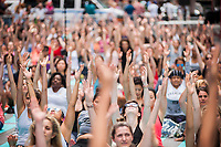 """Over 12,000 yoga practitioners pack Times Square in New York to practice yoga on the first day of summer, Wednesday, June 21, 2017. The 15th annual Solstice in Times Square, """"Mind Over Madness"""",  stretches the yogis'  ability to block out the noise and the visual clutter that surround them in the Crossroads of the World. (© Richard B. Levine)"""