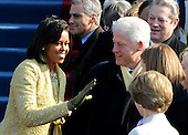 Washington, DC - January 20, 2009 -- Soon to be First Lady Michelle Obama greets former President Bill Clinton and Laura Bush as she arrives for the inauguration of the Barack Obama as the 44th President of the United States on the west steps of the Capitol on Tuesday, January 20, 2009. .Credit: Pat Benic - Pool via CNP