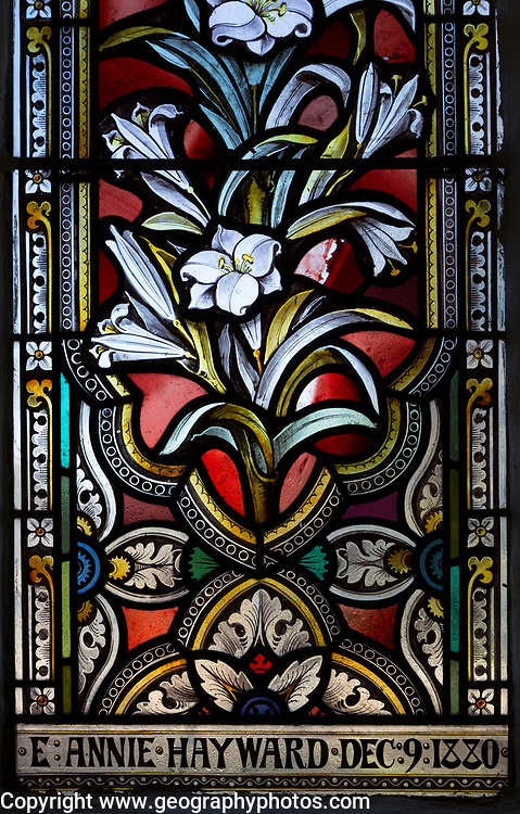 Stained glass window church of Saint Nicholas, Wilsford, Wiltshire, ornamental floral pattern lilies circa 1880 by ward and Hughes