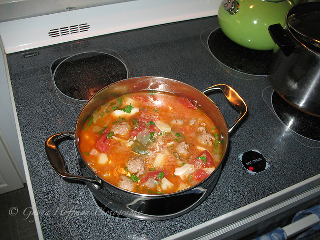 Portuguese fish stew in pot on stove.