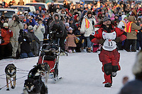 Tuesday March 13, 2007   ----   Lance Mackey, the 2007 Iditarod champion arrives in Nome pointing at his lucky number 13 bib.