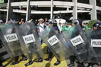 Mexican fans yell at United States fans as they leave Azteca Stadium under a police escort. Mexican police officers in riot gear separated the team's fan supporters to prevent any violence. The United States Men's National Team played Mexico in a CONCACAF World Cup Qualifier match at Azteca Stadium in, Mexico City, Mexico on Wednesday, August 12, 2009.