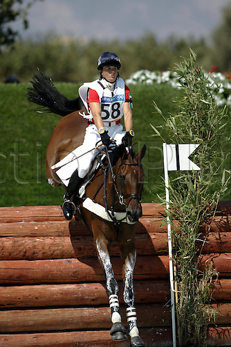 17 August 2004: British rider Pippa Funnell (GBR) riding Primmore's Pride jump a fence at the lake on the Cross Country course during the Eventing Competition held at the Markopoulo Olympic Equestrian Centre. Funnell was awarded the individual bronze medal after a decision by the Court of Arbitration for Sport. 2004 Olympic Games, Athens, Greece. Photo: Neil Tingle/Action Plus...040817 olympics olympic three-day event three day events 3-day 3 day eventing eventer eventers equestrian sport sports.