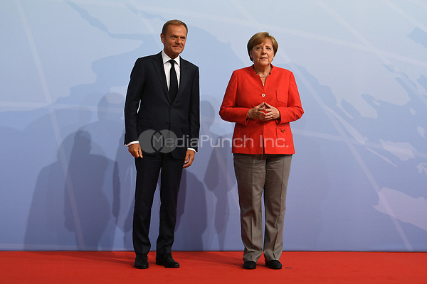 German chancellor Angela Merkel greets Donald Tusk, the the president of the European Council, at the G20 summit in Hamburg, Germany, 7 July 2017. The heads of the governments of the G20 group of countries are meeting in Hamburg on the 7-8 July 2017. Photo: Bernd Von Jutrczenka/dpa-pool/dpa /MediaPunch ***FOR USA ONLY***
