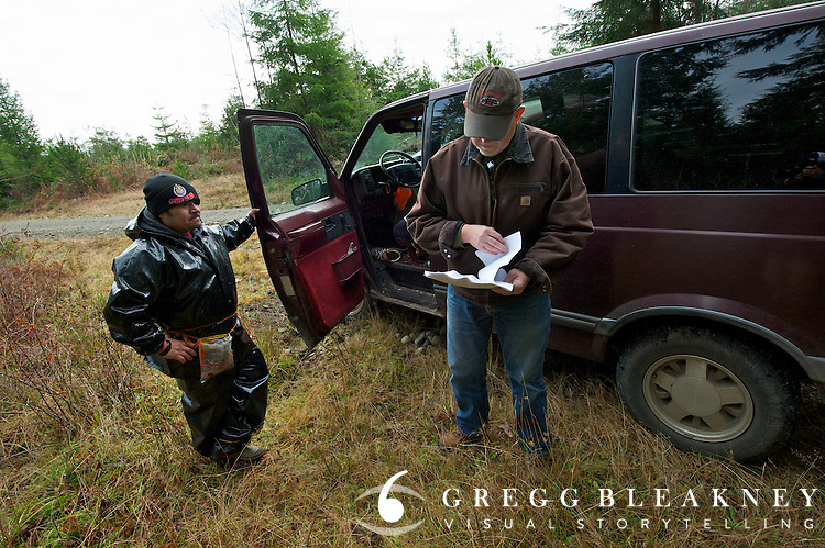 Jim Furabotten -Checks documentation of salal pickers. They had legal permits. - Olympic Peninsula, WA State