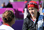 LONDON, ENGLAND 08/30/2012:  Line Tremblay talks to her assistance Linda Gagnon while competing in the Women's Individual Recurve- W1/W2 at the London 2012 Paralympic Games in the Royal Artillery Barracks. (Photo by Matthew Murnaghan/Canadian Paralympic Committee)