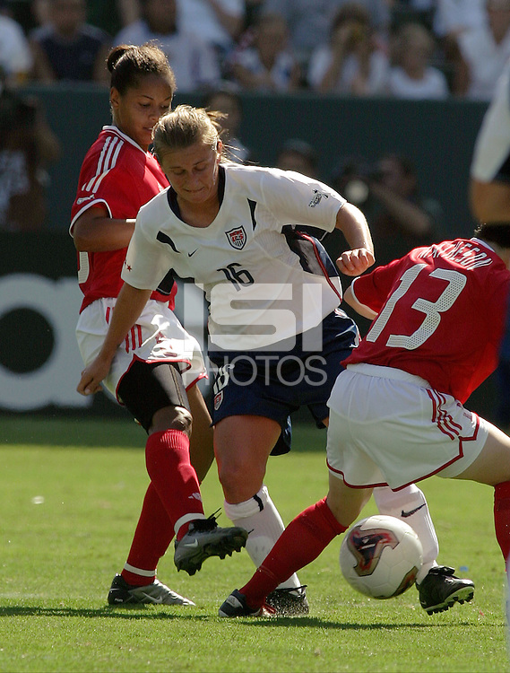 Tiffany Milbrett, USA vs. Canada at the Third Place Match of the FIFA Women's World Cup USA 2003. USA 3, Canada, 1. (October 11, 2003). .