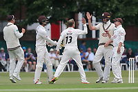 Gareth Batty of Surrey is congratulated by his team mates after taking the wicket of Nick Browne during Surrey CCC vs Essex CCC, Specsavers County Championship Division 1 Cricket at Guildford CC, The Sports Ground on 10th June 2017