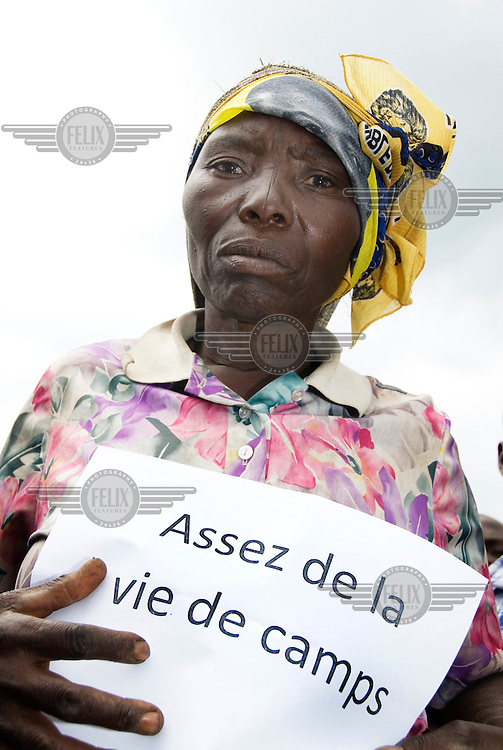 In the Mugunga I IDP (Internally Displaced Persons) camp, Simwirayi Batema attends a demonstration organised by her women's group SAUTI (Sauti ya Mwanamke Mkongomani), which means Voices of the Women of Congo. Her placard reads, 'Enough of camp life.'