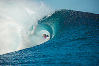 TEAHUPO'O, Taiarapu/Tahiti (Friday, August 16, 2013): Adrian Ace Buchan (AUS) slots into g a barrel on day two of the contest. Buchan won the Billabong Pro on the next day of competition. Contest organisers at the 6th stop on the 2013 ASP (Association of Surfing Professionals) Men&rsquo;s World Championship Tour decided to continue the Billabong Pro Tahiti today. With light winds and a south west swell in the 4'-6' range the contest kicked off at 7.30 am this morning with the eight remaining Round Two heats and then completed eight heats in Round Three. Highlights of the day included Jeremy Flores (FRA) scoring nearly the perfect score with a 10 point ride backed up by a high 9 point  Mick Fanning (AUS) posting a perfect 10 point ride to defeat wildcard surfer Ian Walsh (HAW) and John John Florence (HAW) putting on a tube riding feast with his own perfect 10 point ride.<br />  Photo: joliphotos.com