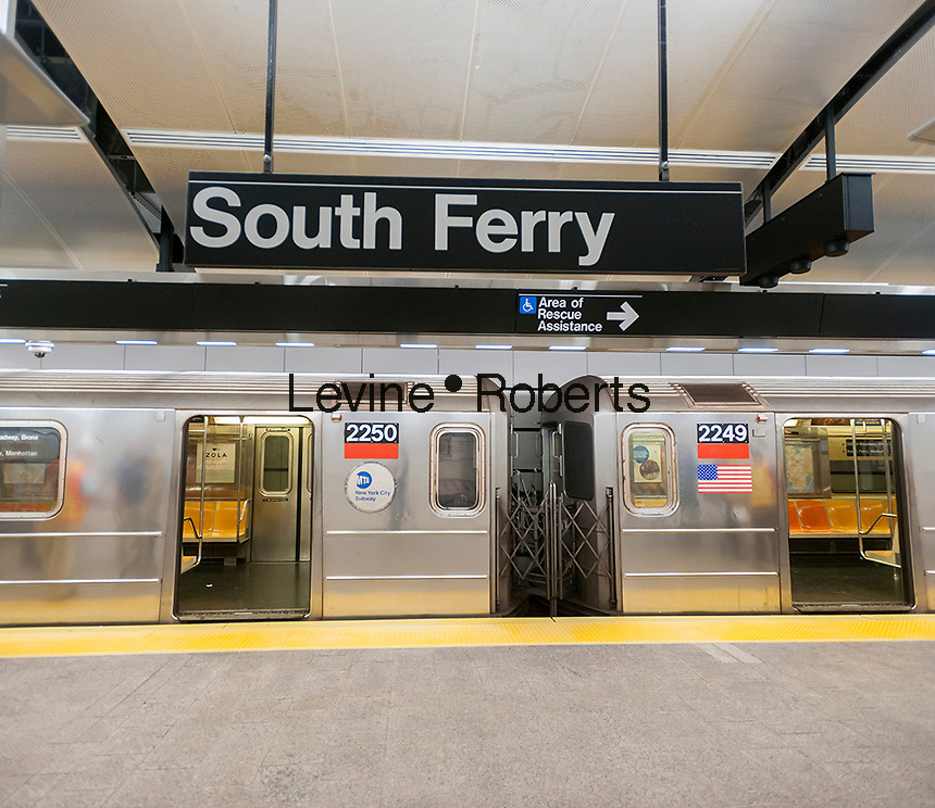 A Number 1 train waits in the newly restored South Ferry subway station in New York on re-opening day Tuesday, June 27, 2017. The restored station was closed after catastrophic damage by Superstorm Sandy with an estimated 15 million gallons of water flooding the terminal which cost $545 million and was only open three years. The $340 million in repairs were finished today nearly five years after Superstorm Sandy. In the interim the Number One train used the quirky old South Ferry loop which only accommodated the first five cars of a ten car train.  (© Richard B. Levine)