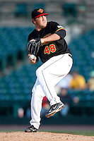 June 21, 2009:  Relief Pitcher Rob Delaney of the Rochester Red Wings delivers a pitch during a game at Frontier Field in Rochester, NY.  The Rochester Red Wings are the International League Triple-A affiliate of the Minnesota Twins.  Photo by:  Mike Janes/Four Seam Images