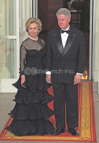 United States President Bill Clinton and first lady Hillary Rodham Clinton await the arrival of Premier Zhu Rongji of the People's Republic of China and his wife, Madame Lao An, for an Official Dinner in their honor on the North Portico of the White House in Washington, D.C. on April 8, 1999.<br /> Credit: Ron Sachs / CNP/MediaPunch