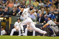 Milwaukee Brewers outfielder Ryan Braun #8 hits a home run during a game against the Los Angeles Dodgers at Miller Park on May 22, 2013 in Milwaukee, Wisconsin.  Los Angeles defeated Milwaukee 9-2.  (Mike Janes/Four Seam Images)
