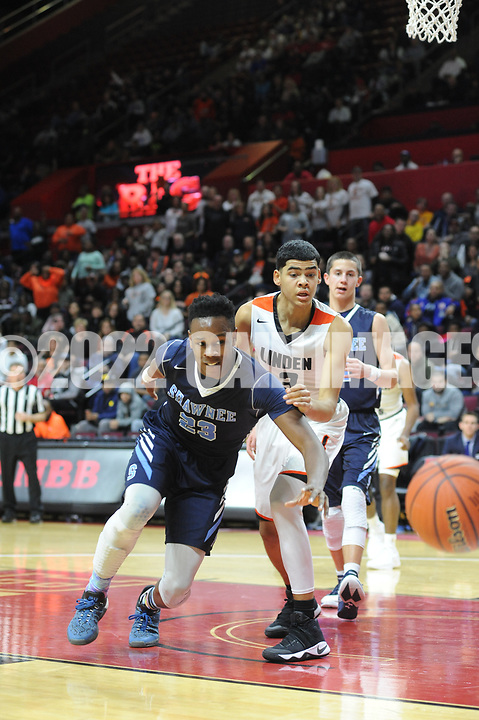 Shawnee's Daevon Robinson (23) chases a loose rebound as Linden's Marcellus Livingston (3) defends in the fourth quarter of the New Jersey Group 4 State Championship game Sunday March 12, 2017 at Rutgers University in Piscataway, New Jersey. (Photo by William Thomas Cain)