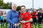 Ger mcGillicuddy presents the man of the match award to Darren O'Sullivan Glenbeigh/Glencar at the Mid Kerry final in Killorglin on Sunday