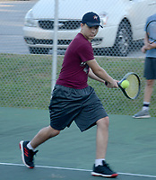 Graham Thomas/Herald-Leader<br /> Siloam Springs tennis player Boone Henley goes for a backhand shot during practice on July 23 at the JBU Tennis Complex.