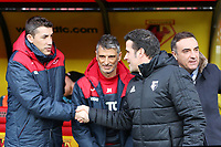 (L-R) Assistant coaches Bruno Lage, Joao Mario Ferreira Oliveira greet Watford manager Marco Silva and Swansea manager Carlos Carvalhal prior tothe Premier League match between Watford and Swansea City at the Vicarage Road, Watford, England, UK. Saturday 30 December 2017