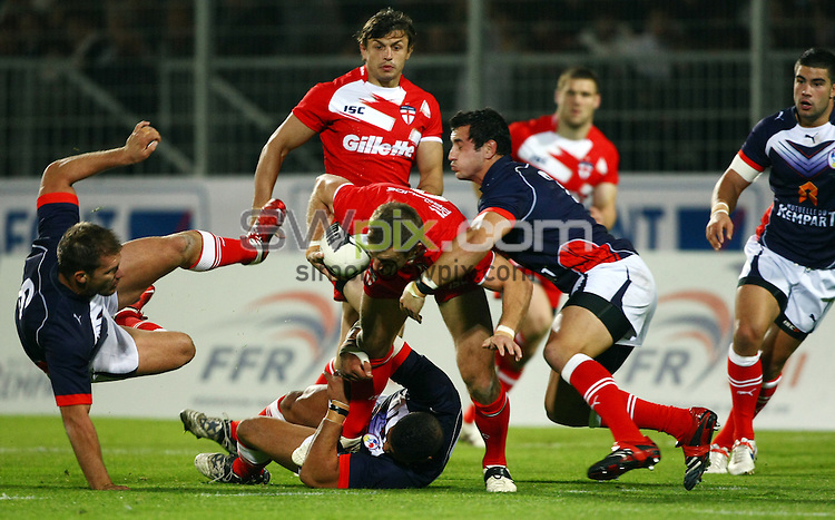 PICTURE BY VAUGHN RIDLEY/SWPIX.COM...Rugby League - International Friendly - France v England - Parc des Sport, Avignon, France - 21/10/11...England's James Roby is tackled by France's Jamal Fakir and VIncent Duport.  Gregory Mounis (L) evades the tackle.