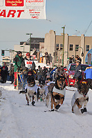 Musher Kelley Griffin and Iditarider  Claudia Goldie.leave the 2011 Iditarod ceremonial start line in downtown Anchorage, Alaska