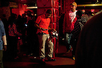 Andre Desir from Queens holds out a pair of Nike Ray Guns sneakers hoping to attract a buyer during Dunkxchange, a market held in a club in New York City, USA, where sneaker collectors trade and sell their rare shoes, 7 January 2007.<br />