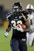 22 November 2008:  FIU running back Julian Reams (32) breaks away on a 40 yard run to the 4 yard line in the ULM 31-27 victory over FIU at FIU Stadium in Miami, Florida.