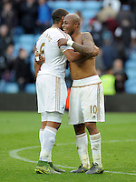 Andre Ayew of Swansea City celebrates with Ashley Williams of Swansea City at the final whistle in the Barclays Premier League match between Aston Villa v Swansea City played at the Villa Park Stadium, Birmingham on October 24th 2015