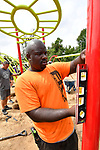 Randy Gautt, an installer with Fry & Associates from Kansas City, checks for level as the playground is assembled. Volunteers from the Pacific Life Foundation, Edward Jones, the Riverview Gardens School District, the Boys & Girls Clubs of Greater St. Louis and the community joined KaBOOM! and transformed an empty site into a kid-designed, state-of-the-art playground at Highland Elementary School on Saturday August 18, 2018. The playground - designed from students' drawings - will give more than 400 kids a safe place to play. KaBOOM! is a national non-profit dedicated to bringing balanced and active play into the daily lives of all kids.  Photo by Tim Vizer