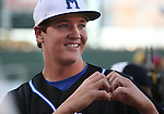 McQueen grad Kody Reynolds gestures to his family before the start of the Triple-A All Star Home Run Derby in Reno, Nev., on Monday, July 15, 2013. Reynolds, who won a high school home run competition to earn a spot in the competition, hit a total of five homers in the event. <br /> Photo by Cathleen Allison