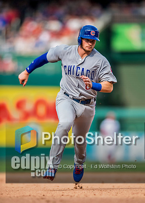 29 June 2017: Chicago Cubs outfielder Ian Happ hustles to third during game action against the Washington Nationals at Nationals Park in Washington, DC. The Cubs rallied to defeat the Nationals 5-4 and split their 4-game series. Mandatory Credit: Ed Wolfstein Photo *** RAW (NEF) Image File Available ***