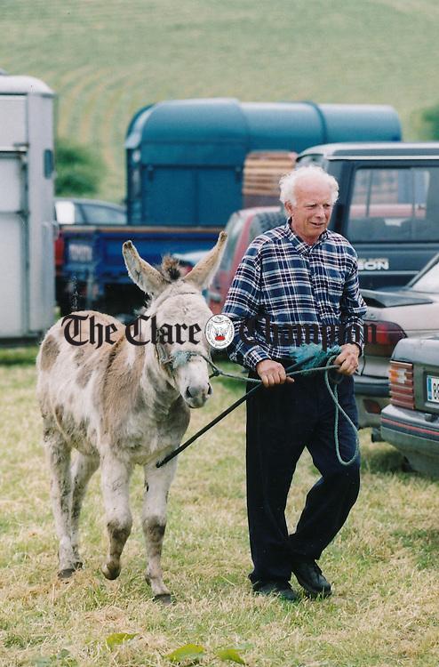 Thomas O'Gorman from Kilrush with his purchase at the fair at Spancilhill - July 2, 1999. Photograph by John Kelly