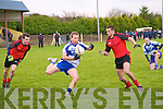 Castleisland's Pat Hichey beats Tarberts Jimmy  Holly & Shane Enright to the ball.