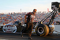 Aug 15, 2014; Brainerd, MN, USA; Crew chief Brian Husen walks away as NHRA top fuel dragster driver Shawn Langdon pulls up to the staging beams during qualifying for the Lucas Oil Nationals at Brainerd International Raceway. Mandatory Credit: Mark J. Rebilas-