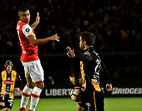 BOGOTA - COLOMBIA – 23 – 05 - 2017: Juan Roa (Izq.) jugador de Independiente Santa Fe, disputa el balon con Matias Alonso (Der.) jugador de The Strongest, durante partido entre Independiente Santa Fe de Colombia y The Strongest de Bolivia, de la fase de grupos, grupo 2, fecha 6 por la Copa Conmebol Libertadores Bridgestone 2017, en el estadio Nemesio Camacho El Campin, de la ciudad de Bogota. / Juan Roa (L) player of Independiente Santa Fe, fights for the ball with Matias Alonso (R) player of The Strongest during a match between Independiente Santa Fe of Colombia and The Strongest of Bolivia, of the group stage, group 2 of the date 6th, for the Conmebol Copa Libertadores Bridgestone 2017 at the Nemesio Camacho El Campin in Bogota city. VizzorImage / Luis Ramirez / Staff.