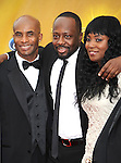 LOS ANGELES, CA. - February 26: Wyclef Jean (center left) and Marie Claudinette Jean arrive at the 41st NAACP Image Awards at The Shrine Auditorium on February 26, 2010 in Los Angeles, California.